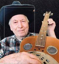 Arnold Hilton ... enjoyed playing the harmonica; at 103