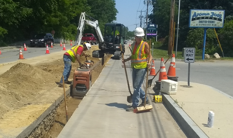 More water, a little less work helps construction crews weather the heat