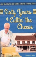 Joel Sherborne talks all things cheese, including cutting it, at Historical Society meet