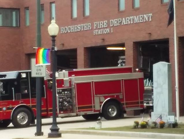 Flag flap roils city on eve of Gay Pride day, 9/11 anniversary