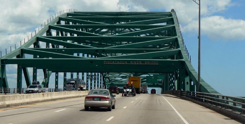 Woman reported in critical condition after jumping from I-95 bridge