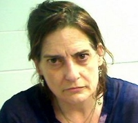 Police arrest woman, seize large amount of heroin, cash