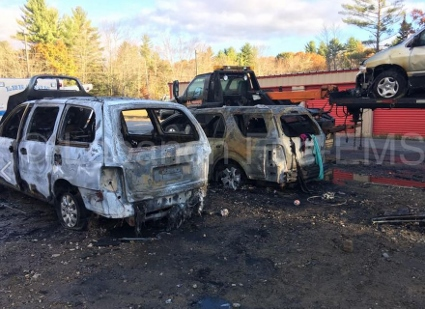 Investigators suspect arson in car dealership blaze that damaged 3 cars, wrecker