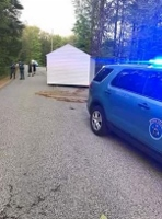 3 reportedly arrested after trying to chain shed to truck and drag it away