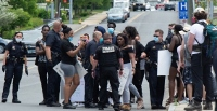 Two in custody after gun incident during Manchester protest of Floyd death