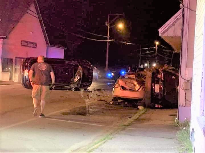 Woman injured, charged with DUI in Milton pileup into parked cars