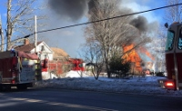 Two firefighters injured in two-alarm Milton Mills blaze