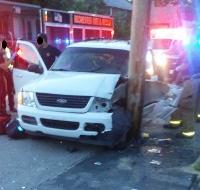 Farmington woman crashes SUV into utility pole