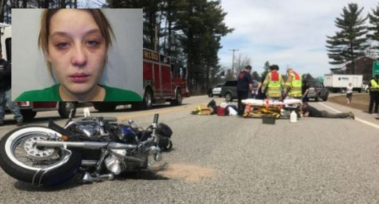 Woman charged in April motorcycle crash turns self in