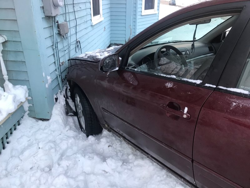 Morning accident snarls Wash. St. traffic, damages house