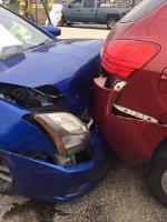 Woman hurt, cited after three-car crash near The Ridge