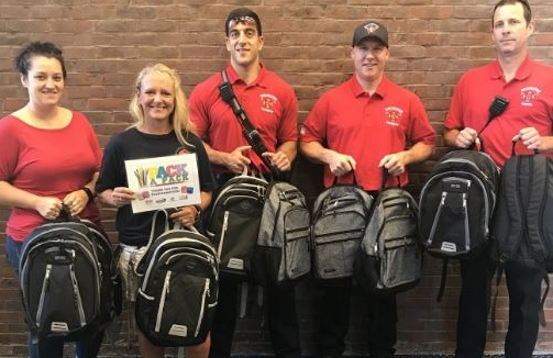 City firefighters step up to help kids go back to school with a full backpack