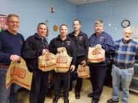 Firefighters fill food bags to keep kids' hunger at bay on weekends