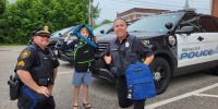 Guyer Travel helps out with backpack outreach