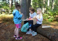 City elementary school students explore outdoor classroom spaces at Pines