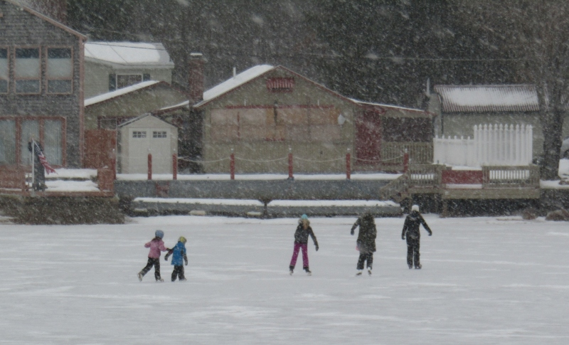 As storm bears down, plowboys take it to the streets while the kids have some fun